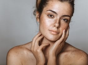 Beautiful young girl with freckle. Studio shot