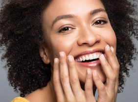 Lady with clear skin promoting the Profound Needling Treatment
