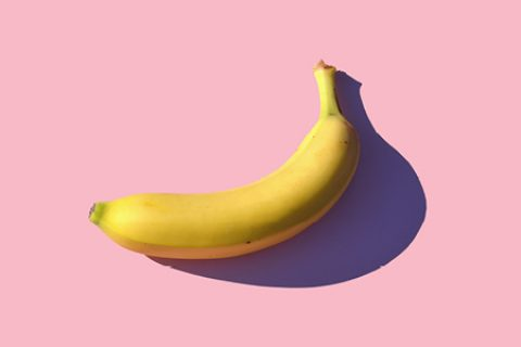 Banana on pink background