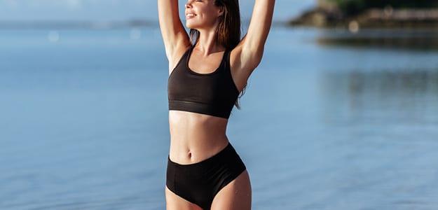 Lady in sports wear near the sea
