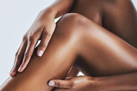 A dark skinned lady's legs