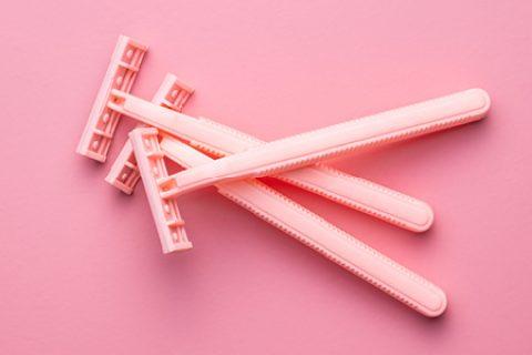 pink razors on pink background