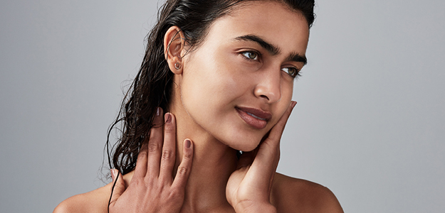 Lady with smooth skin on grey background